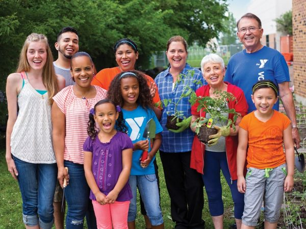 Diverse-group-of-adults-and-children-volunteering-at-YMCA
