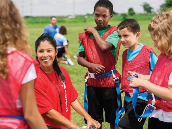 Kids-Playing-Soccer-At-Summer-Sports-Camps