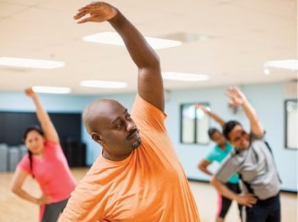 Man-Taking-Group-Exercise-Class-YMCA-Huntsville